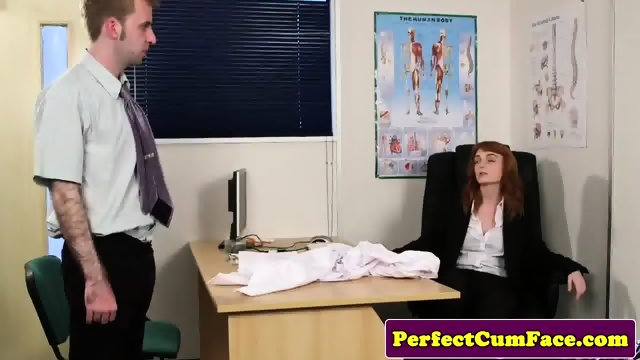 Stockinged redhead facialized in office - scene 1