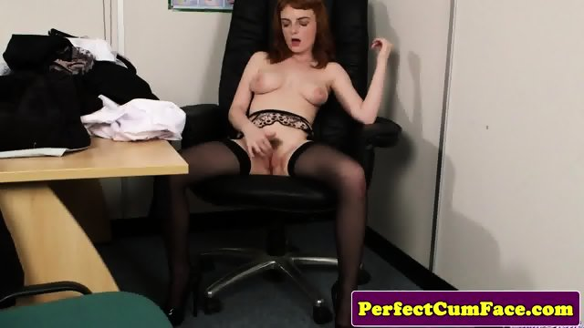 Stockinged redhead facialized in office - scene 5