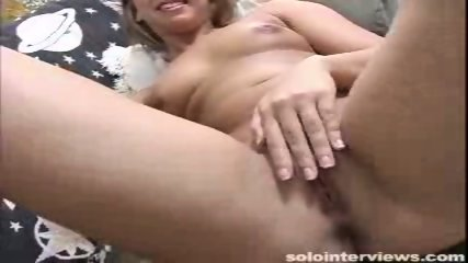 Brianna fingers her pink shaved pussy