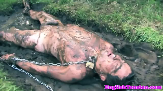 Mistress pissing on sub outdoors in the mud - scene 11