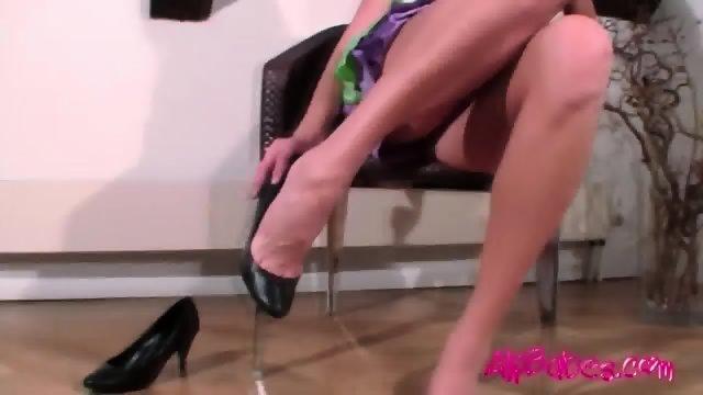 Hot blonde massages her feet