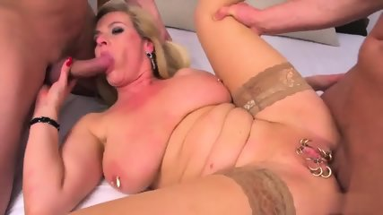 Pierced Mature With Big Tits Has Two Cocks In Her Holes