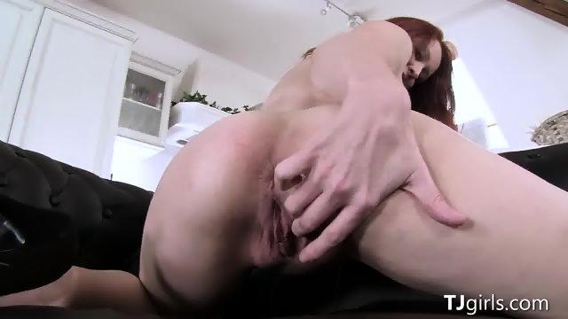 Redhead Gina Spreads Her Ass