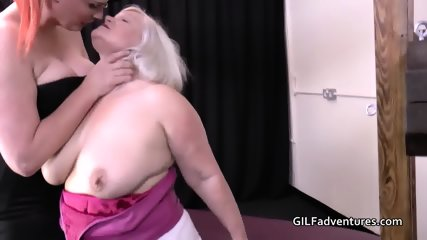 Large redheaded lady dominates and toys a mother and step daughter