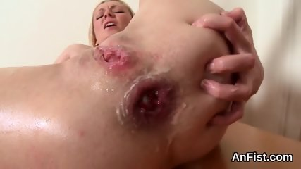 Slutty lesbian bombshells are opening up and fisting anals - scene 12