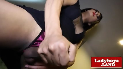 Busty Thai tranny rubbing her candy bar