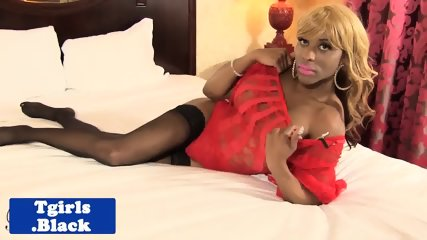 Bigboob ebony tgirl strokes her thick dick