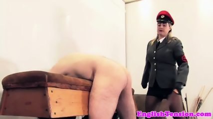 BDSM mistress whipping her sub