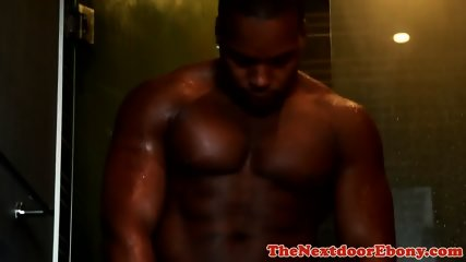 Beefy ebony athlete plays with himself