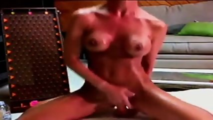 Busty Brunette Oils Up & Rides Dildo