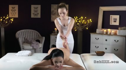Natural busty lesbian eats masseuses cunt