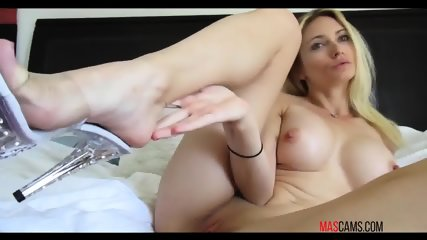 Blond chick with big boobs having fun in fingering her wet pussy on webcam