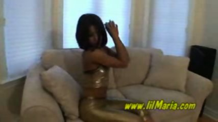 Tight ebony in gold outfit stripping - scene 1