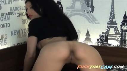 Watch her undress and finger her trimmed cunt