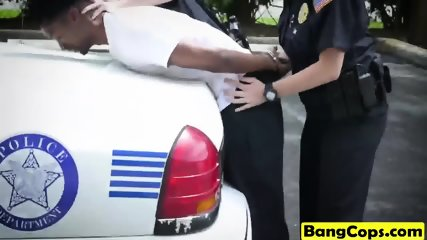 Two slutty cops take black schlong outdoors