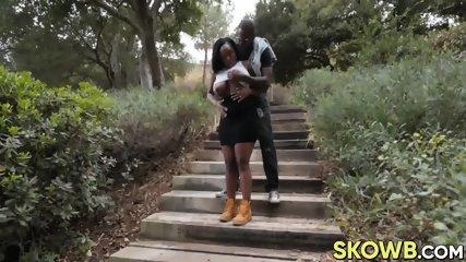 Black bimbo with big jugs enjoys having her ass smashed