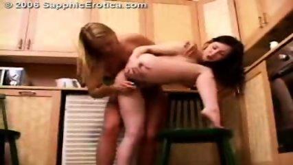 Horny Lesbians fool around in the kitchen - scene 10