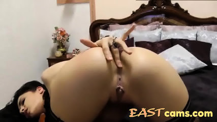 Sexy and beautiful Amerasian girl fucks her ass on livecam