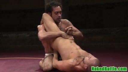 Muscular stud deepthroating after wrestling