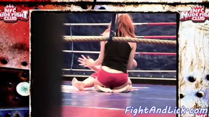 Redhead babe wrestles her les opponent
