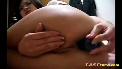 Asian girlie pushing a toy up her tight pooper hole