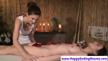 Lesbian masseuse fingered gently by client