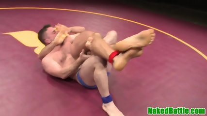 Athletic stud gives fellatio while wrestling
