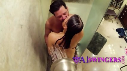 Lovely couple taking shower together