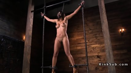 Brunette in device bondage cunt vibrated