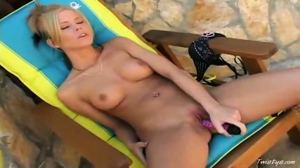 Jenna Sweet takin out the purple dildo outdoors - scene 11