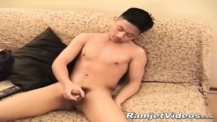 Good looking Asian dude wanks his rock solid cock solo