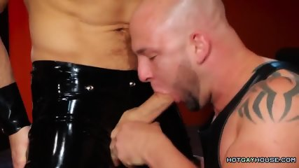 Tattooed muscled stud fucks bald guy