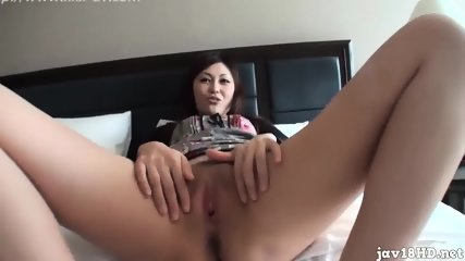 Young girl testing big dildos