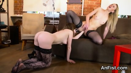 Wicked lesbo models are stretching and fisting anuses