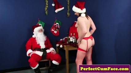 Naughty Christmas babe cocksucks santa POV