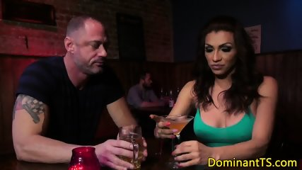 Busty transgender sucks guys cock at the bar