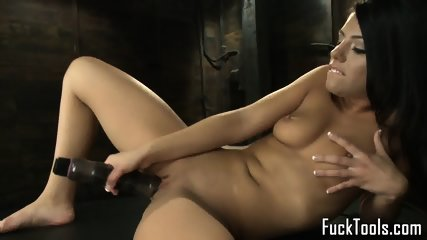 Busty babe toys pussy before sybian swing