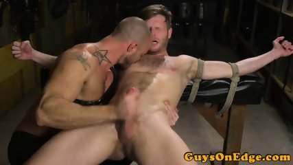 Tattooed Bdsm Dom Edging Restrained Subs Cock