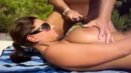 Surprise cumshot for milf on beach