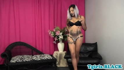 Tattooed ebony tgirl with big round ass solo