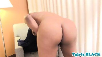 Teasing tgirl jerks hard cock after stripping
