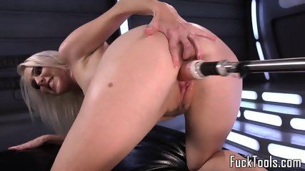 Busty blonde pussy toyed by dildo machine