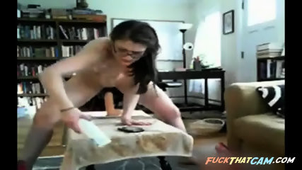 Riding dildo in her ass makes nerd sweat