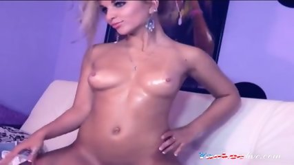 Blonde cam model with shiny oiled sexy body teases