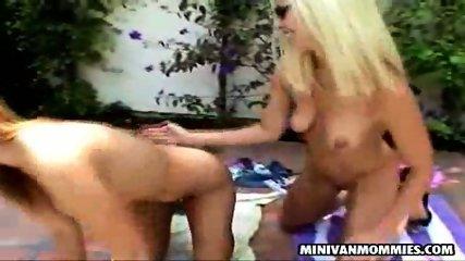 Two lesbian MILFs taking a sunbath - scene 10