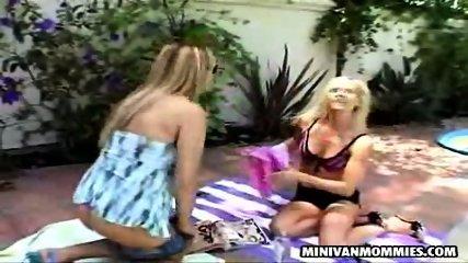 Two lesbian MILFs taking a sunbath - scene 3