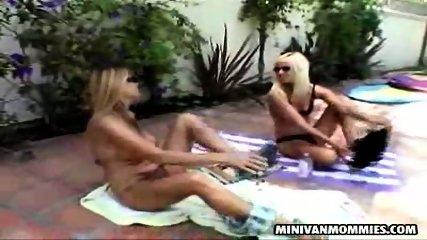 Two lesbian MILFs taking a sunbath - scene 5