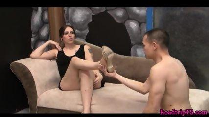 Footworshiped tgirl sucks cock on her knees