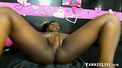 Big tit black slut fucks herself