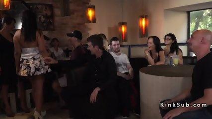 Slave gets orgy facial in public bar